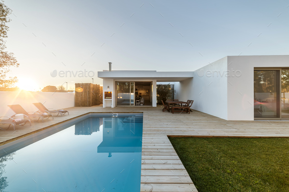 Modern house with garden swimming pool and wooden deck - Stock Photo - Images