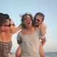 Two Couples Laughing Near the Sea During Summer Time - VideoHive Item for Sale