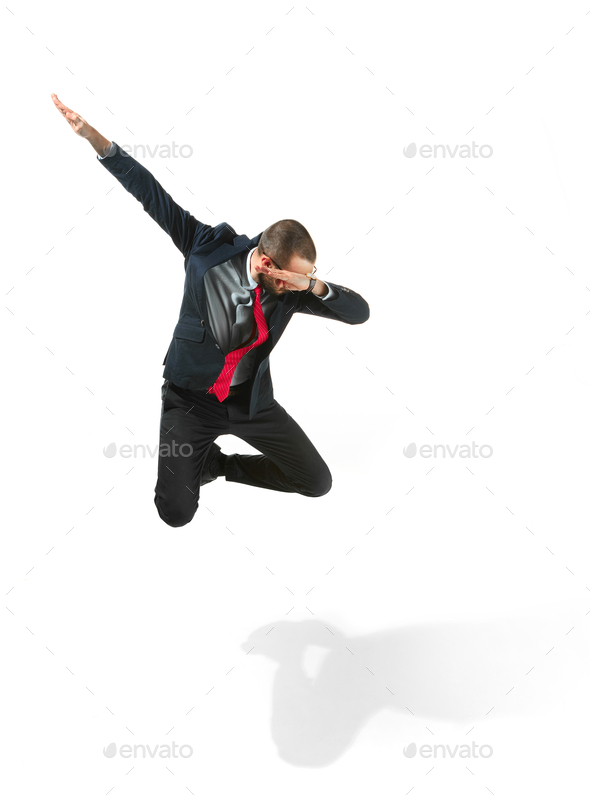 Funny cheerful businessman jumping in air over white background - Stock Photo - Images