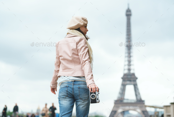 Young girl with a retro camera - Stock Photo - Images