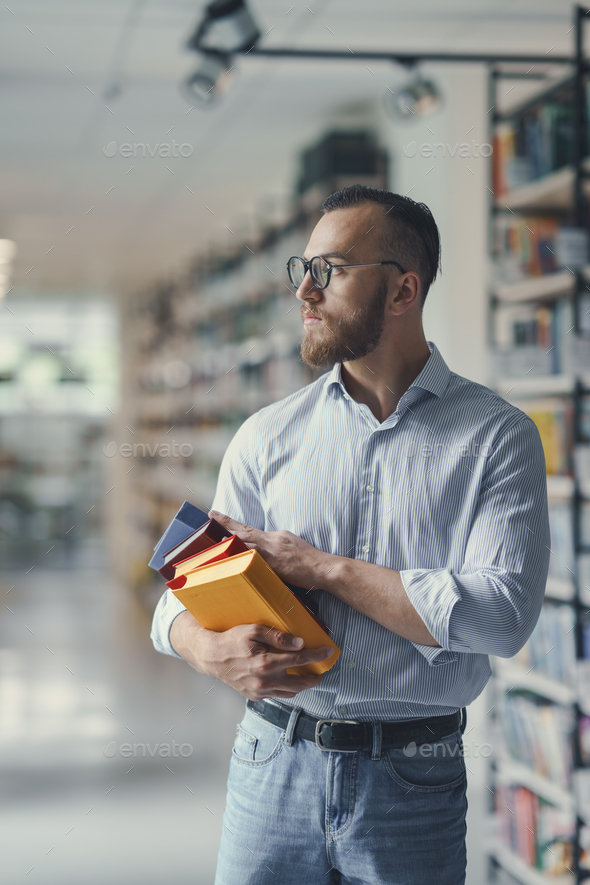 Man in a library - Stock Photo - Images