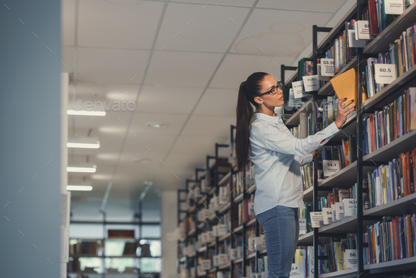 Student in a library - Stock Photo - Images