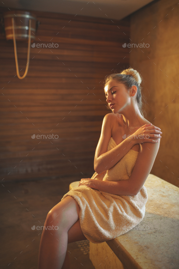 Young woman in spa - Stock Photo - Images