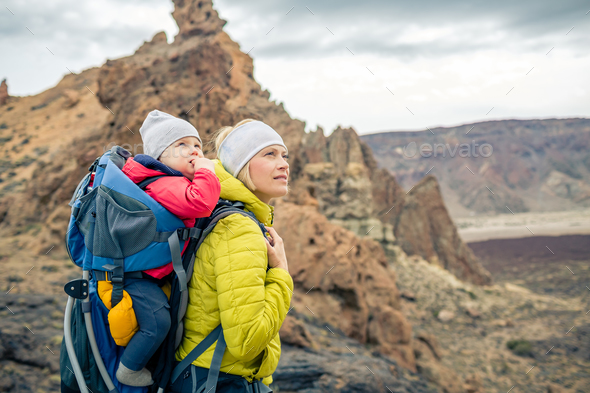 Family hike, mother with baby in backpack - Stock Photo - Images