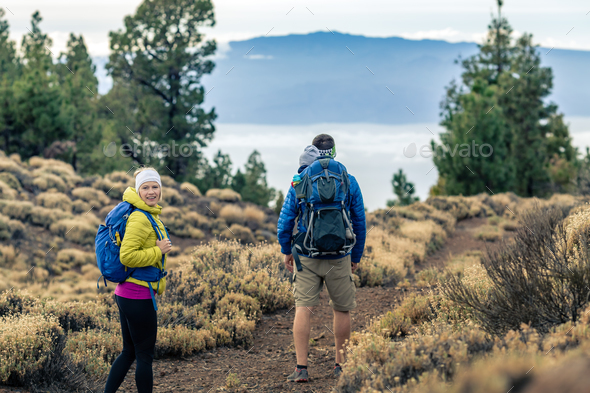 Couple hiking with baby boy travelling in backpack - Stock Photo - Images