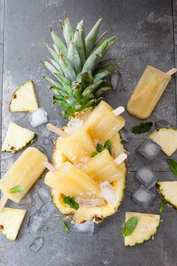 Frozen pineapple popsicles - Stock Photo - Images
