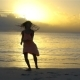 Adorable Happy Little Girl Have a Lot of Fun on White Beach at Sunset. - VideoHive Item for Sale