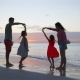 Happy Beautiful Family on White Beach Having Fun in the Evening - VideoHive Item for Sale