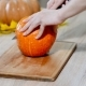 Cutting Raw Pumpkin Slice. Woman Cutting Orange Pumpkin Piece. Raw Pumpkin Cut - VideoHive Item for Sale