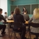 Woman Lecturer Speaks To Students in Classroom - VideoHive Item for Sale