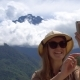 Young Female Traveler Taking Selfie with Mountain Active Tourism - VideoHive Item for Sale