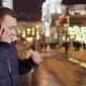 Young Handsome Guy Talks on Phone at Night City Background - VideoHive Item for Sale