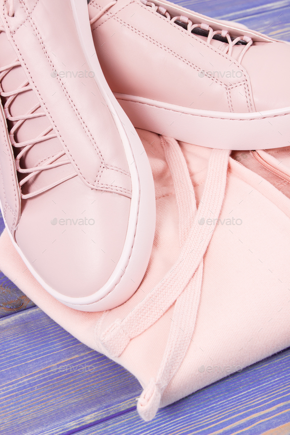 Womanly clothing and accessories on old boards, leather shoes and sweatshirt - Stock Photo - Images