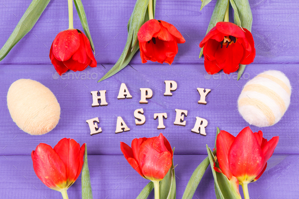 Inscription Happy Easter, tulips and eggs wrapped woolen string on boards, festive decoration - Stock Photo - Images