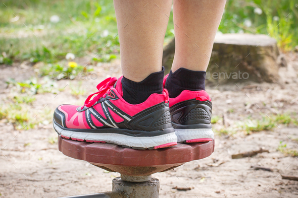 Legs of elderly senior woman on outdoor gym, healthy lifestyle concept - Stock Photo - Images