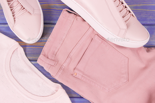 Womanly clothing and accessories on old boards, leather shoes, sweater and pants - Stock Photo - Images