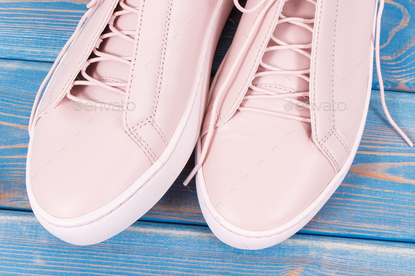 Pair of pink leather shoes for woman on old blue boards - Stock Photo - Images