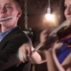 A Guy in a Jacket and Shirt Plays the Flute, and a Beautiful Brunette in a Blue Dress Playing the - VideoHive Item for Sale