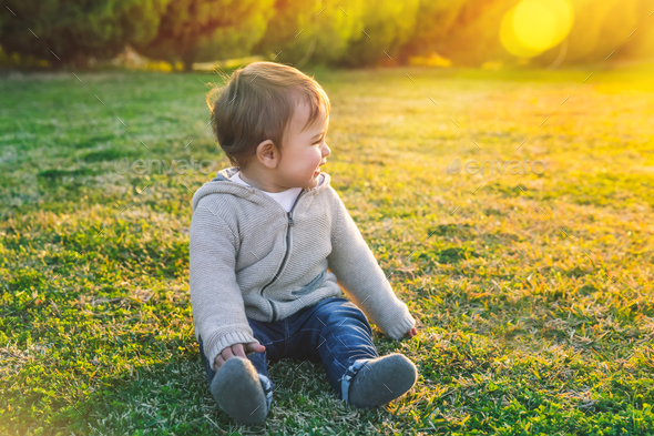 Adorable baby playing outdoors - Stock Photo - Images