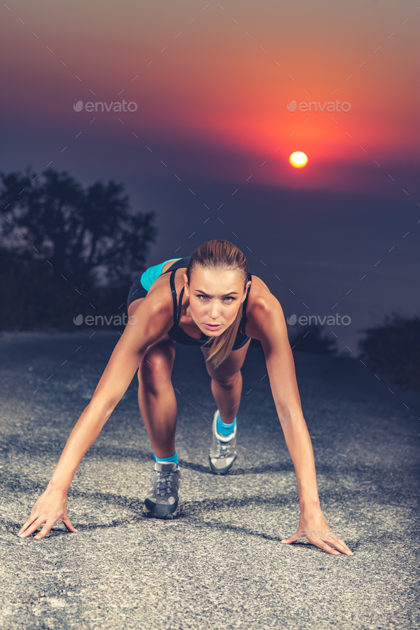 Sprinter woman on the start - Stock Photo - Images