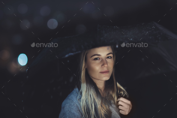 Beautiful woman at rainy night - Stock Photo - Images