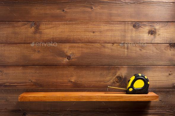 tape shelf at wooden shelf - Stock Photo - Images