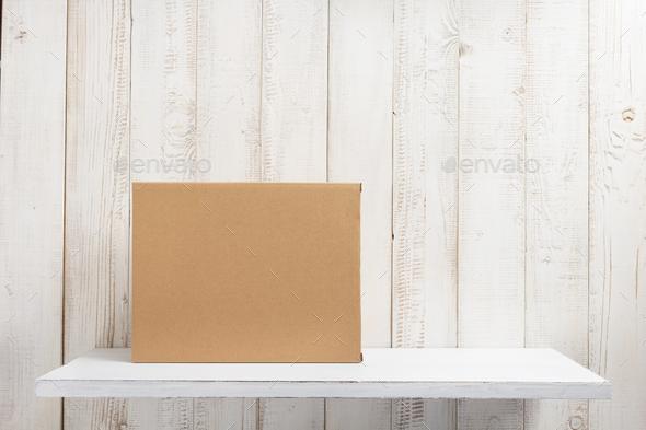 cardboard box on wooden shelf - Stock Photo - Images