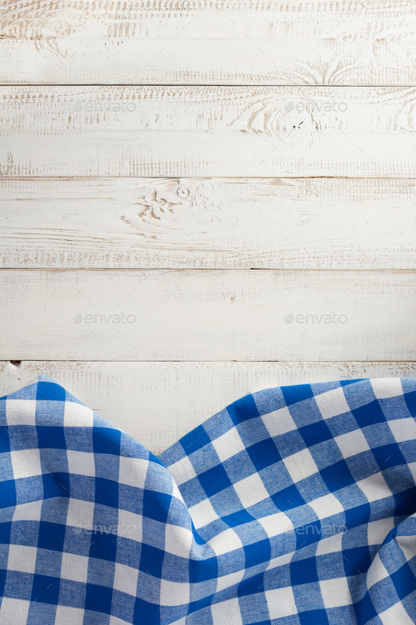 checked cloth napkin on wood - Stock Photo - Images