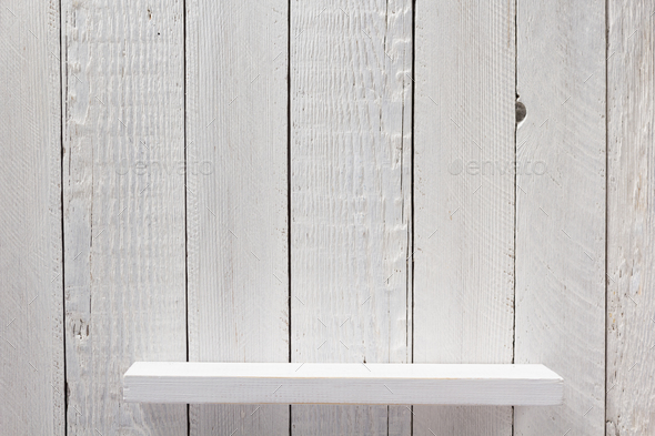 white shelf on wooden wall - Stock Photo - Images