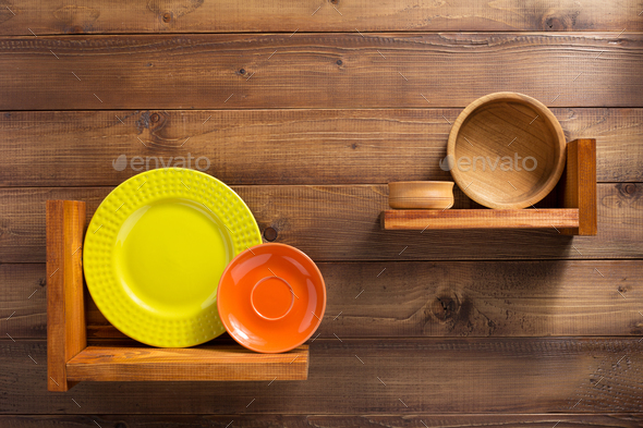 plate at kitchen wooden shelf at wall - Stock Photo - Images