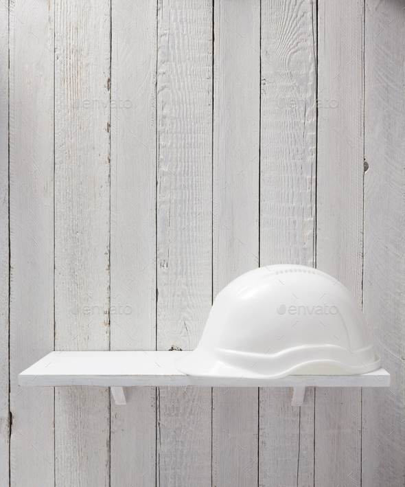 construction helmet on shelf - Stock Photo - Images