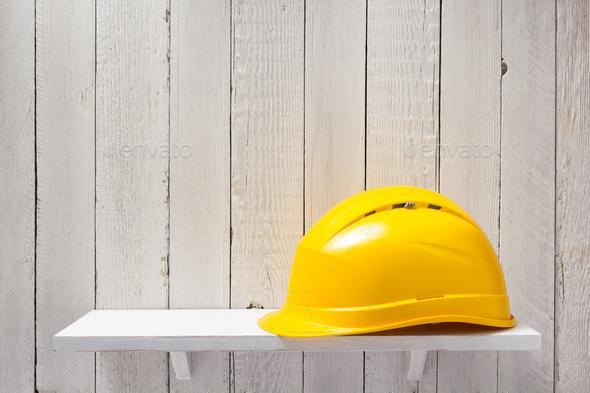 construction helmet on shelf - Stock Photo - Images