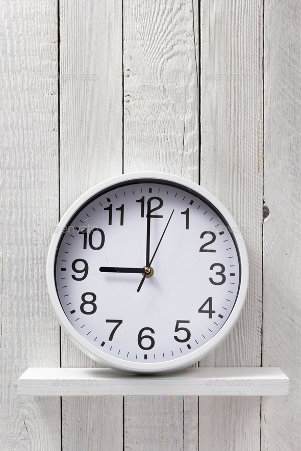 wall clock at wooden shelf - Stock Photo - Images