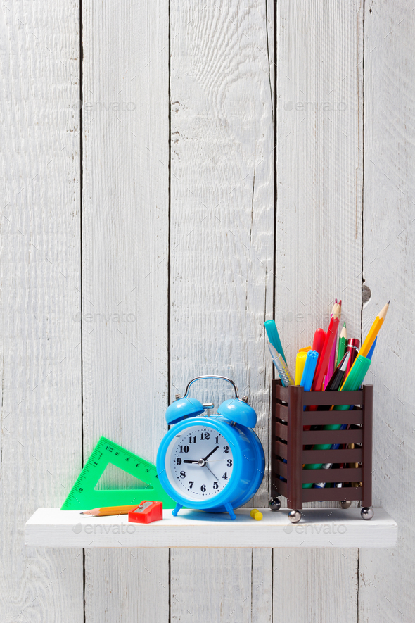 school supplies and tools at wooden shelf - Stock Photo - Images