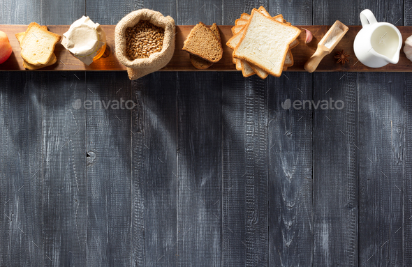 bread and bakery products on wood - Stock Photo - Images