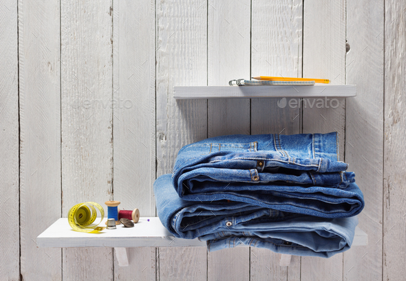 blue jeans on wooden shelf - Stock Photo - Images