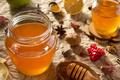 glass jar of honey on paper - PhotoDune Item for Sale