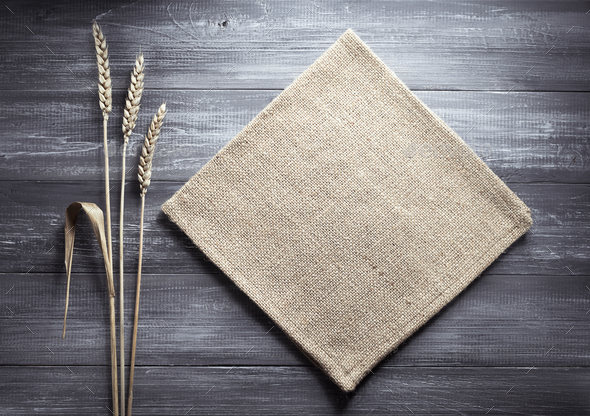 ears of wheat and cloth on wood - Stock Photo - Images