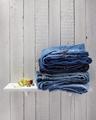blue jeans on wooden shelf - PhotoDune Item for Sale