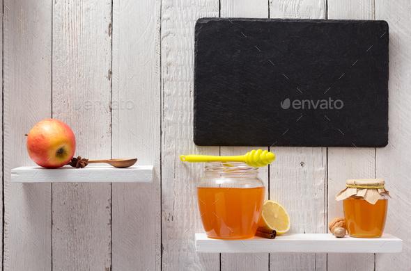 glass jar of honey on wooden shelf - Stock Photo - Images