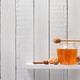 glass jar of honey on wooden shelf - PhotoDune Item for Sale