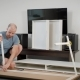 Guy Is Assembling a Furniture Himself in a Room, Installing Long White Beams on a Carcass of Modern - VideoHive Item for Sale