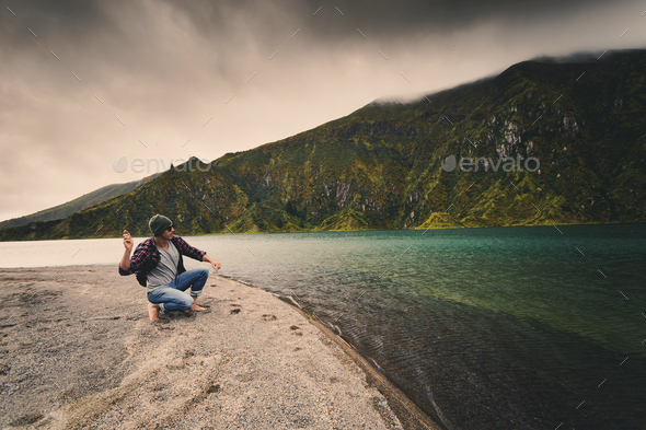 Man throwing a stone - Stock Photo - Images