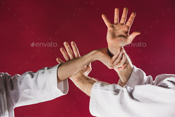Two men fighting at Aikido training in martial arts school - Stock Photo - Images