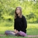 Girl with a Sports Figure Is Engaged in Yoga in Central Park - VideoHive Item for Sale