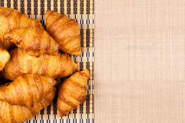 Close up top view on delicious fresh baked golden croissants - Stock Photo - Images
