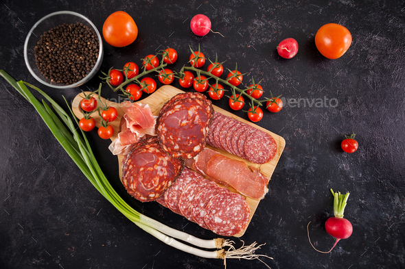 Top view of delicious healthy meat appetizers on wooden board - Stock Photo - Images