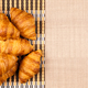Close up top view on delicious fresh baked golden croissants - PhotoDune Item for Sale