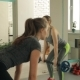 Young Women Do Exercises with a Barbell in the Gym - VideoHive Item for Sale