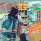 Father, Mother and Little Daughter Choosing Fruits in Supermarket. Mom, Dad and Girl Selecting - VideoHive Item for Sale